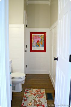 From Sarah at thriftydecorchick.blogspot.com, a new twist on half-wall paneling. See how she used wood planks placed horizontally to freshen up her half-bath. | thisoldhouse.com