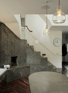 Wow, reface your fireplace with some gorgeous tile.  Check out cement tiles in patterns that are reminders of Morocco