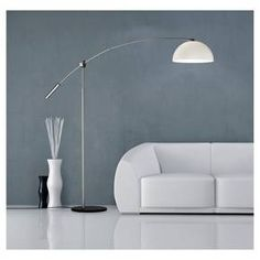 The Adesso Outreach Arc Lamp in Silver combines grace and engineering to deliver a fabulous, contemporary lighting option. This stunning floor lamp has a sturdy black base and sleek, polished silver column. A soaring bridge arm curves out into the room to drape over a modern couch or reading lounge. The ivory toned hard lamp shade is the perfect counterpart to the silver handle on the arm. A foot switch allows for easy operation.