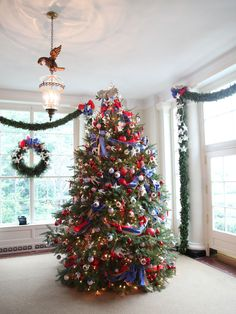 The First Lady's Military Appreciation Tree stands in the East Entrance Landing. The ornaments and ribbon commemorate each military branch, and a dove carrying an olive branch tops the tree. As a way to show appreciation to the men and women who serve the country, White House visitors are given the opportunity to send troops a personal holiday message, and the President will pay the postage.