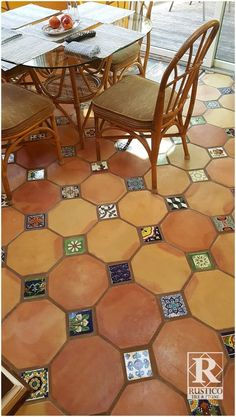Painted #talavera tile inserts play up this traditional #saltillo tile patio floor! Get this look from RusticoTile.com - We offer wholesale prices and worldwide shipping. RusticoTile.com #rusticotile #mexicantile #spanishstyle #interiordesignideas #terracotta #flooring