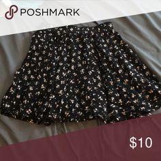 Flowy skater skirt Super cute flowy skirt with a dainty flower pattern Brandy Melville Skirts Mini