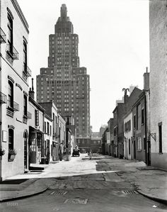 """March 20, 1936. """"Macdougal Alley, between West 8th Street and Washington Square North, Manhattan. 1 Fifth Avenue rises above."""" 8x10 gelatin silver print by Berenice Abbott for the Federal Art Project.  Shorpy Historic Picture Archive"""
