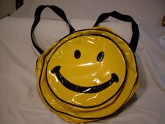 Smiley-face backpack purses - I had 2 of these: one like the bag shown in the photo and one with the colors reversed.