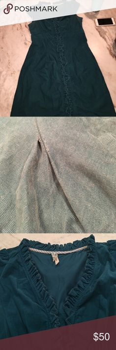 Anthropologie corduroy dress Color is teal. Color is darker in picture. Second picture shows how a small part of the stitching is coming undone but could easily be fixed. Can't tell when wearing Anthropologie Dresses Midi