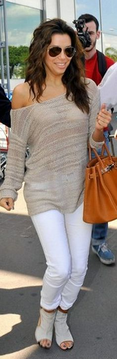 Who made Eva Longoria's brown tote handbag, white skinny jeans, and cut out shoes that she wore in Cannes on May 16, 2012?