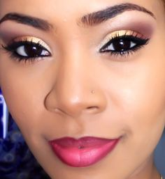 gold to maroon on eyes with heavy black liner and lashes. pink lips with darker lip liner.