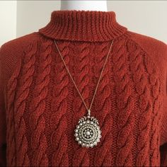 Cable knit sweater dress with Aztec leggings! Burnt orange sweater dress with matching Aztec leggings! Leggings are size medium from Deb and sweater dress is a large. The sweater is a thick wool material. Deb Dresses