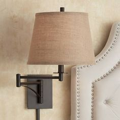 Handsome and functional, this plug-in swing arm wall lamp features a matte brown finish with a rustic burlap hardback shade.