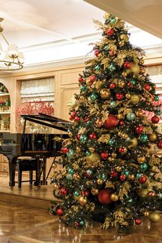 At Christmastime, afternoon tea at Fortnum & Mason is accompanied by classical carols, wafting from a grand piano nearby. Ribbon On Christmas Tree, Christmas Tree Design, Christmas Tree Themes, Xmas Tree, Christmas Wreaths, Christmas Ideas, Christmas In Heaven, Beautiful Christmas Trees, Christmas Love