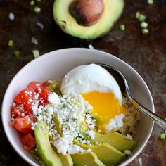 Quinoa Avocado Breakfast Bowl Recipe Breakfast and Brunch with cooked quinoa, olive oil, green onions, crushed rosemary, salt, ground pepper, hard-boiled egg, california avocado, tomatoes, feta cheese crumbles