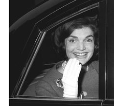 Mrs. Kennedy returned to London for a visit with her sister, Princess Lee Radziwill. I read the daily press bulletin from Buckingham Palace and saw that they were expected for lunch with the Queen. I ran from outside Princess Radziwill's home to Buckingham Palace and took this photograph as their limousine was about to turn into the gate. Recently when I showed the photograph to a close friend of Mrs. Kennedy's he immediately said, 'That was taken before 1963.' And when I asked him how he…