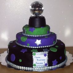 3 Tier Chocolate Mousse Filled Marble cake with a working disco ball.   This was a cake I created for a 12 year old girl's birthday party.