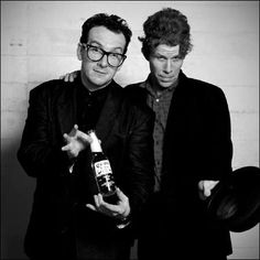 Two of my favorites, Elvis Costello and Tom Waits, offering you a beer.