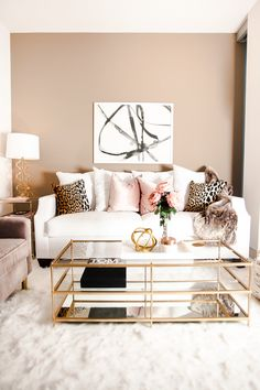 Not my usual style but I really love this! Love the leopard cushions, the mink/beige wall and the gold and glass table.