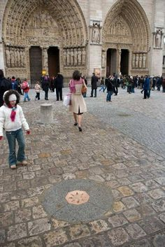 Point Zero Paris in front of Notre Dame, ths is the most magical place I have been. spin 3 times and make a wish!!