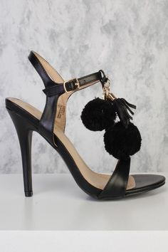 Catch every bodys attention with this beautiful pom pom heels! This heels are perfect to wear with some boyfriends jeans or your favorite body con party dress! Featuring an open toe, side ankle buckle closure, a gold high polish chain t-strap and pompom accent. Approximately a 3 inch heel.