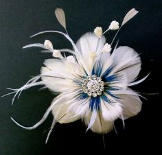 I can't decide between feathers or flowers for a fascinator... so why not a flower made of feathers? :-)