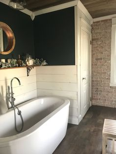 Vintage inspired farmhouse bathroom shiplap dark green and brick wall #decoratingbathrooms