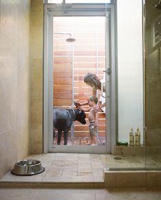 Indoor Outdoor Shower indoor shower with sliding doors to an outdoor shower, which has a