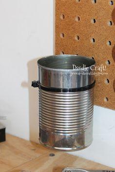 Peg Board  + garden ties + tin cans