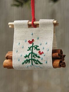 Christmas Log Carrier Ornament Cross Stitch Pattern Fragrant cinnamon sticks take the place of logs in this clever, Christmassy design. Christmas Log, Cross Stitch Christmas Ornaments, Xmas Cross Stitch, Christmas Embroidery, Counted Cross Stitch Patterns, Cross Stitch Designs, Cross Stitching, Cross Stitch Embroidery, Embroidery Patterns
