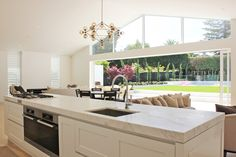 This kitchen's understated elegance blends into the large, light filled family living space. The intention was to ensure the kitchen did not act as the focal point of the interior but instead to highlight the streamline architecture and landscape surroundings. The scullery behind the tall cabinets is an excellent solution for hiding the secret workingsRead more