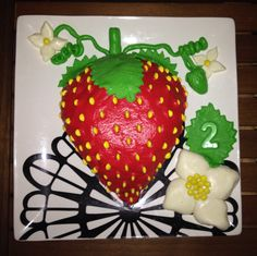 My daughters love for strawberries lead to her 2nd birthday cake, used marshmallow playdough, great fun, easy to use and tastes great!