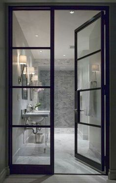 Black & glass doors into bathroom