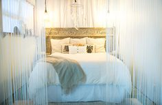 beach style bedroom by Ashley Camper Photography, the coolest part of this bedroom is that amazing headboard, wow!