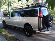 Chevy GMC van with Aluminess tire rack, roof rack and ladder. Ford Trucks For Sale, Big Trucks, Ambulance, Van Roof Racks, Van People, Lifted Van, Gmc Vans, Build A Camper Van, Tire Rack