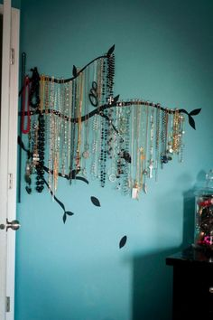 This one reminds me of Rocio's room...painted on the wall w little pins/hooks to hang necklaces on. Love this one!