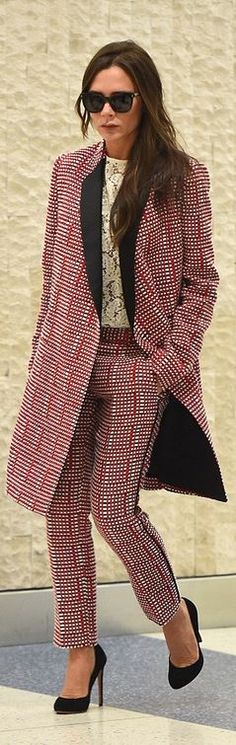 Who made Victoria Beckham's red print pants and black print coat?