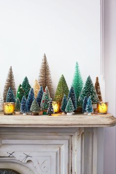 When decking your own halls, consider these charming touches. Classic in inspiration and modern in execution, they bring cheer to nearly every room in the house and are as easy to implement as one, two...tree.   Cue the Conifers Make your mantel look amazing with a colorful assortment of vintage and inexpensive evergreens. The bottle‐brush variety are readily available online and at crafts stores; the miniature ones were plucked from a model train set. Votives make the snow‐dusted landscape…
