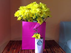 Recycled gift bag and pen holder into flower vases.  Cute!!!