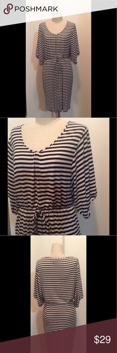 "Calvin Klein 6 blk/Ivory elbow sleeve knit dress. Gathered hem elbow sleeve knit dress. Black/Ivory stripe. Self drawstring 33"" from center back beck to hem. Scoop neck size 6. Calvin Klein Dresses"