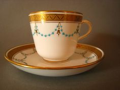 A Set of 8 Stunning Minton Tea cups & Saucers with turquoise jewelling and 24ct gold gilt