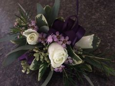 Ivory spray rose, pink wax flower, purple ribbon, pittosporum, eucalyptus corsage #SunshineDesigns #HiltonPensacolaBeach #HiltonPeanscaolBeachWedding #PensacolaBeachWedding #BeachWedding