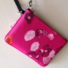 HOST PICKCoach fuschia/floral wristlet, NWT Coach fuschia/floral wristlet, black strap, fuschia interior with 2 slot pockets, silver hardware, 6.5x4.25. Coach Bags Clutches & Wristlets