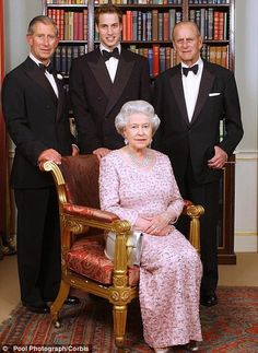 Elegant: Queen Elizabeth wears a sequin embellished pastel pink gown as she poses with her consort, Prince Philip, pose with their son Prince Charles, the Prince of Wales, and his son, Prince William. Three generations of the British Royal Family gathered at Clarence House