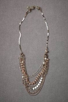 """Eight uniquely detailed arcs made of beads, links, and blush-toned Swarovski crystals create a halo of beauty. From St. Erasmus. S-loop closure. Length adjustable: 20"""" to 22.5""""L, 4""""W. Swarovski crystals, glass beads, acrylic pearls, brass."""