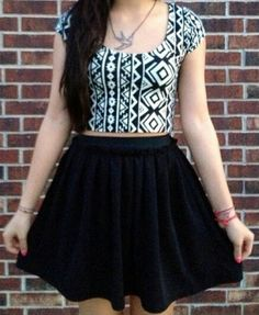 Black Hugh waisted skirt with a tribal printed crop top