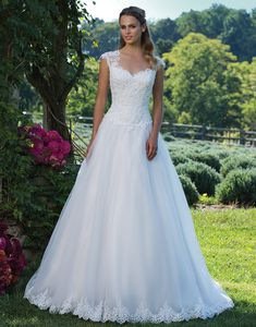 Sincerity Bridal 3982 Ivory/Nude Size 28 With beaded lace appliques, a Queen Anne neckline and basque waist, this gown is the epitome of timeless romance. A full tulle skirt with a cathedral length train mean that your exit will be as unforgettable as your entrance. https://www.sinceritybridal.com/wedding_dress/3982