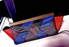 «#JustCavalliFW15 clutch enriched by patchwork colourways.»