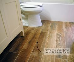 Faux wood tiles are a great flooring material for bathrooms. They'll blend with the rest of your home's wood floors, but you don't have to worry about water damage. | From Shannon of Fabulously Vintage blog