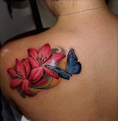 Realistic Red Lily And Butterfly Tattoos on Shoulder Realistic Butterfly Tattoo, Butterfly With Flowers Tattoo, Butterfly Tattoo Cover Up, Lily Flower Tattoos, Butterfly Tattoo On Shoulder, Butterfly Tattoos For Women, Best Tattoos For Women, Butterfly Tattoo Designs, Cover Tattoo