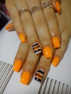 Orange dream nails with black and white stripes