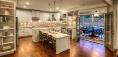 Traditional Kitchen with Farmhouse sink, Kitchen island, Pendant light, Hardwood floors, Limestone Tile, U-shaped, Flush
