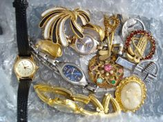 Vintage Jewelry lot Mixed Brooches, Watches, Earrings..Relic, Bulova, Fossil