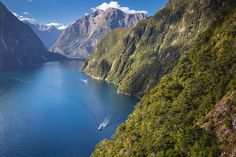 "Milford Sound Day & Overnight Cruises Real Journeys Explore the magnificent Milford Sound fiord either as a day cruise (scenic or nature) or overnight cruise (which includes accommodation, activities, dinner and breakfast. We also offer coach connections from Queenstown and Te Anau which connect to our Milford Sound cruises."" Our family business was founded in Fiordland in the 1950's by tourism and conservation pioneers Les and Olive Hutchins. Mountainous Terrain, Milford Sound, Tours, South Island, Hiking Trails, New Zealand, Te Anau, Beautiful Places, National Parks"